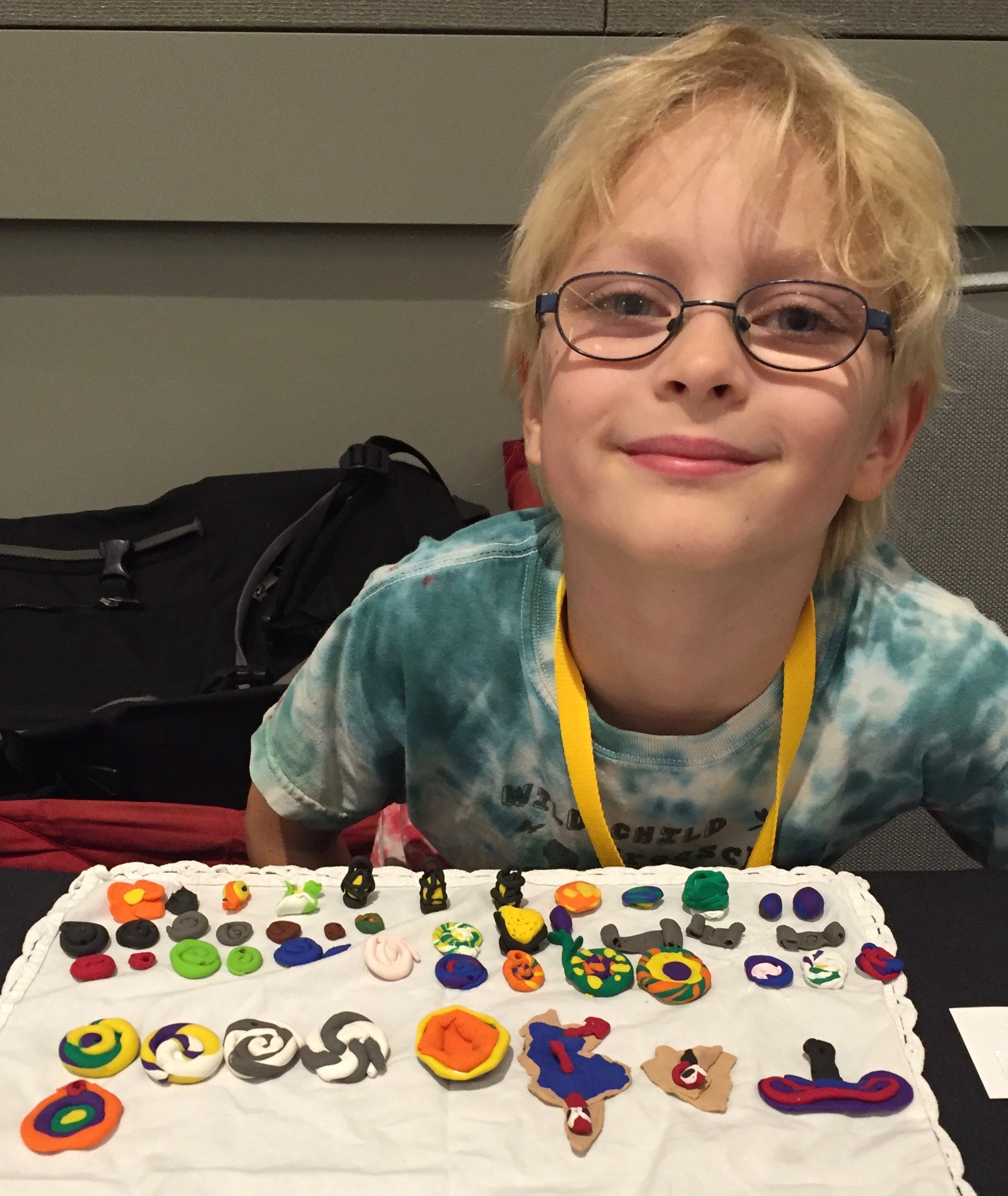 Boy selling his clay crafts at homeschool conference.