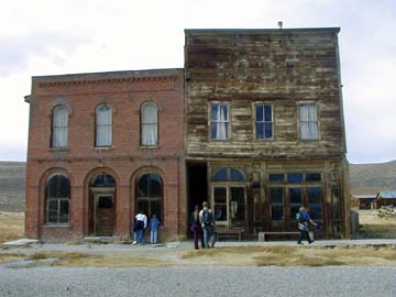 The brick building is the Dechambeau Hotel and Post Office. The wooden building is the I.O.O.F. Hall on Main Street, Bodie, CA, ghost town.